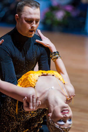 latinamerican: Minsk, Belarus-February 14,2015: Professional Dance Couple of Divtsov Dmitrii and Gribkova Mariya from Turkey Performs Adult Latin-American program on IDSA World Professional 10 Dance Championship on February 14, 2015, in Minsk, Republic of Belarus Editorial