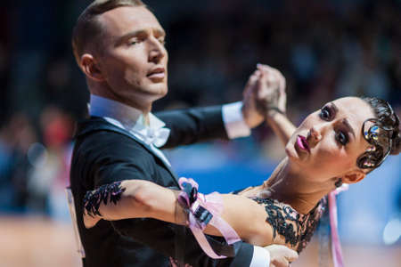 10 15 years: Minsk, Belarus-February 15, 2015: Dance Couple of Parfyonov Denis and Sopit Tetiana from Ukraine Performs Adult Standard European Program on IDSA World Professional 10 Dance Championship on February 15, 2015, in Minsk, Republic of Belarus