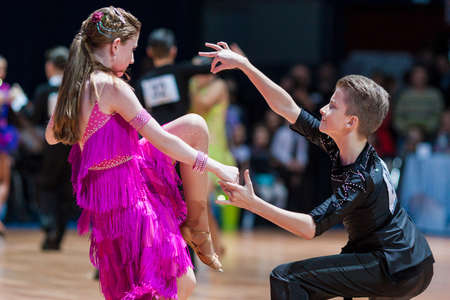 10 15 years: Minsk, Belarus-February 15, 2015: Unidentified Professional Dance Couple Performs Youth-2 Latin-American program on IDSA World Professional 10 Dance Championship on February 15, 2015, in Minsk, Republic of Belarus Editorial