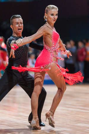 latinamerican: Minsk, Belarus-February 15,2015: Kosyakov Egor and Belmach Anastasiya from Belarus Performs Adult Latin-American program on IDSA World Professional 10 Dance Championship on February 15, 2015, in Minsk, Republic of Belarus Editorial