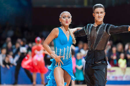 latinamerican: Minsk, Belarus-February 15,2015: Lebed Denys and Tikhonova Kateryna from Ukraine Performs Adult Latin-American program on IDSA World Professional 10 Dance Championship on February 15, 2015, in Minsk, Republic of Belarus