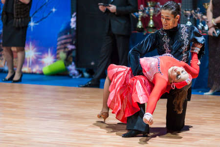 10 15 years: Minsk, Belarus-February 15,2015: Aitimbetov Mykola and Dolzhykova Jaroslava from Ukraine Performs Adult Latin-American program on IDSA World Professional 10 Dance Championship on February 15, 2015, in Minsk, Republic of Belarus