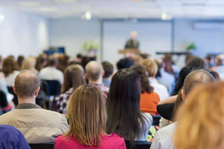 Business Concept: Group of People Listening on a Conference Hall. Horizontal Image Orientation Stock Photo