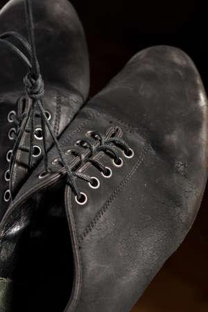 wornout: Closeup Shot of Pair of Wornout Latin Ballroom Dance Shoes. Against Black Background. Horizontal Image Orientation