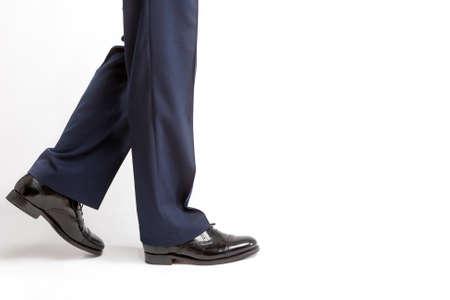 against white: Footwear Concept: Closeup of Stylish Black Shiny Male Semi-Brogue Against White. Horizontal Image Orientation