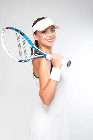 professional sport: Professional Tennis Concept: Female Tennis Player Equipped in Professional Sport Gear  Holding Racket. Vertical Image Composition