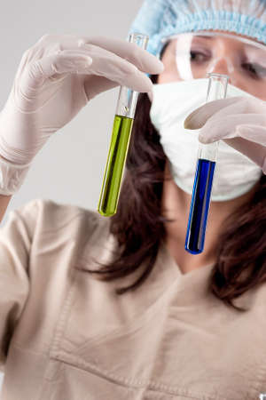 h1n1 vaccination: Medical Concept: Female Laboratory Staff Exploring Glass Flask with Color Liquid. Vertical Image Conceot Stock Photo