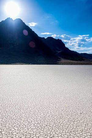 death valley: Unique Racetrack Playa in Death Valley National Park in California State. Vertical Image Composition