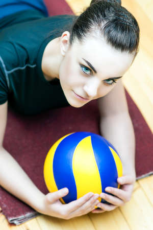 female volleyball: Professional Female Volleyball Player with Ball