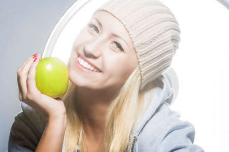 hysterics: Healthy Lifestyle Concept. Closeup Portrait of Smiling Caucasian Woman With Green Apple.Horizontal Image Stock Photo