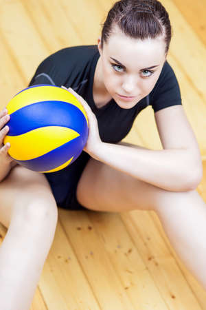 female volleyball: Female Volleyball Player with Ball. Vertical Image Stock Photo