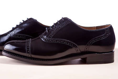 brogue: Mens Fashion Footwear Concept. Pair of Black Fashionable Male Oxfords Semi-Brouge Laced Shoes. Horizontal Image
