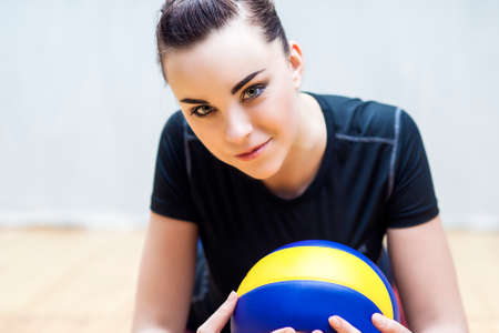 female volleyball: Female Volleyball Player with Ball.Horizontal Image