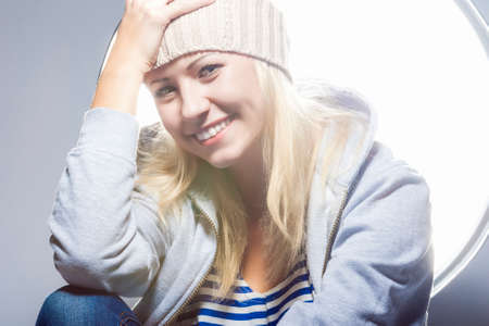 hysterics: happy and Positive Young Caucasian Blond Female Against Studio Equipment. Horizontal Image Orientation