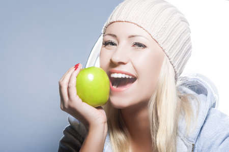 hysterics: Healthy Lifestyle Concept. Portrait of Smiling Caucasian Woman With Green Apple.Horizontal Image Stock Photo