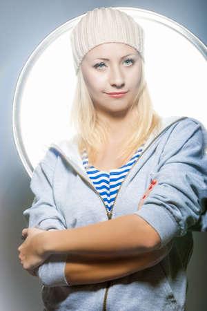 Fashion Concepts. Nice Portrait of Smiling Positive Caucasian Blond Female Posing Against Studio Environment. Vertical Image Stock Photo