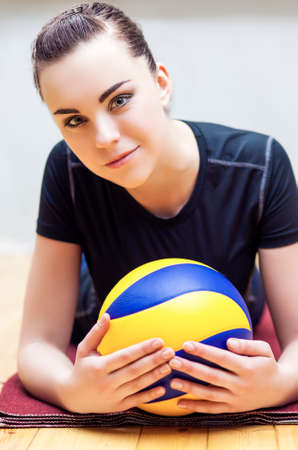 female volleyball: Professional Female Volleyball Player Posing With Ball