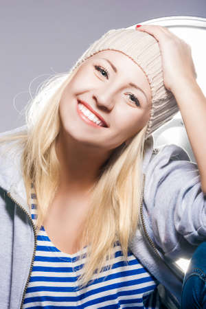 hysterics: Happy and Positive Young Caucasian Blond Female Against Studio Equipment.Vertical Image Composition