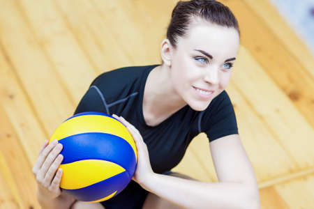 female volleyball: Smiling Happy Female Volleyball Player in Professional Playing Gear Posing With Ball. Stock Photo
