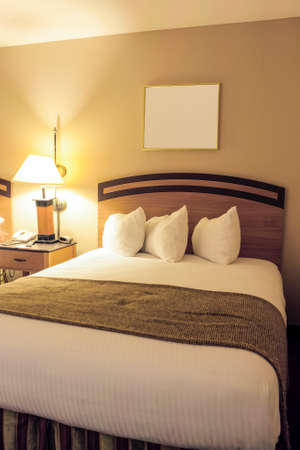 king size: Classic Bedroom Enterior with King Size Bed and Line of Arranged Pillows. Evening Time Bedroom.Vertical Composition