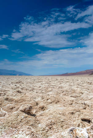 parch: Badwater basin in Californian Death Valley National Park Area Located below Sea Level in USA. Vertical Image Composition Stock Photo