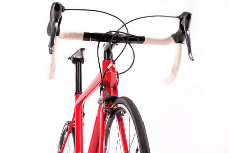 handle bars: Sport Concept. Professional Road Bicycke With Red Carbon Frame. Against White. Horizontal Image Foto de archivo