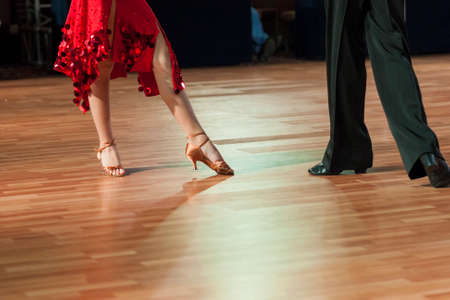 dancefloor: Closeup of Legs of Two Professional Dancers Performing Latin -American Program on Dancefloor. Horizontal Image Composition