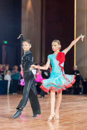 florin: Minsk, Belarus –September 26, 2015: Barbos Florin and Jarbuzov Iolanta Perform Juvenile-1 Latin-American Program on III International IDSA World Dance Championship Capital Cup Minsk- 2015 on September 26, 2015, in Minsk, Belarus