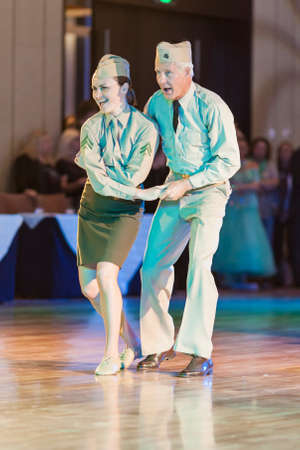 show case: Minsk, Belarus – September 26, 2015: John Gusenhoffer and Irina Lobanova (USA) perform Pro-Am Show Case Dance Show on III International IDSA World Dance Championship Capital Cup Minsk- 2015 on September 26, 2015, in Minsk, Belarus Editorial
