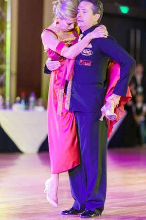 show case: Minsk, Belarus – September 26, 2015: Italian Dance Couple perform Pro-Am Show Case Dance Show on III International IDSA World Dance Championship Capital Cup Minsk- 2015 on September 26, 2015, in Minsk, Belarus Editorial