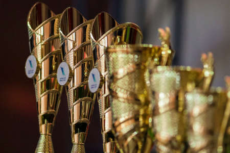 goldy: Minsk, Belarus-September 27, 2015: IDSA Dance Championship Capital Cup Minsk- 2015 Award Cups Lineup Prepared in Line Shot on September 27, 2015,in Minsk, Belarus