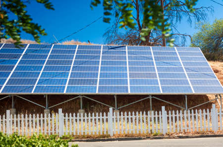 solar array: Roof of Domestic Building Equipped with a Solar Panels Array. Horizontal Image Composition