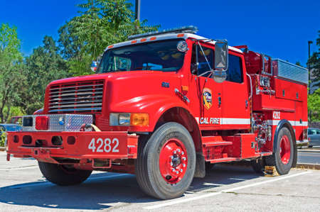 outside machines: California-United States, July 12, 2014: Iconic Red Color American Fire Engine Equipped with Fire-Fighting Tools on Parking Place Stop on July 12, 2014 in California, United States Of America.