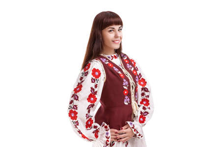 flowery: Traditions Concept. Caucasian Brunette Woman in Flowery Hand-Made Unique Dress. Isolated Over White Background. Horizontal Image