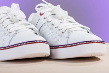 plimsoll: Closeup of Fashionable Modern Laced Sneakers in White. Horizontal Image Composition