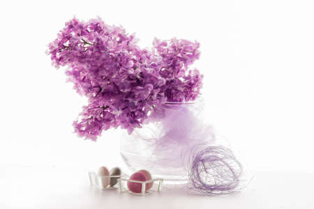 decorative accessories: Bouquet of Spring Fresh Lilacs on Vase With Decorative Accessories. Against White. Horizontal Image Composition