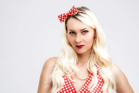 charm temptation: Caucasian Female Blond Woman Posing in Pinup Style Clothes Against White Background. Horizontal Image Composition