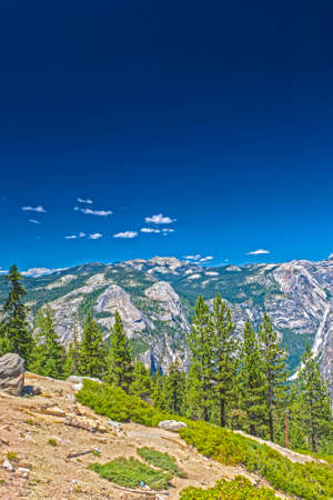 vertical orientation: Beautiful Mountains Shot from High Poing in Yosemite National Park in California. HDR Image. Vertical Orientation