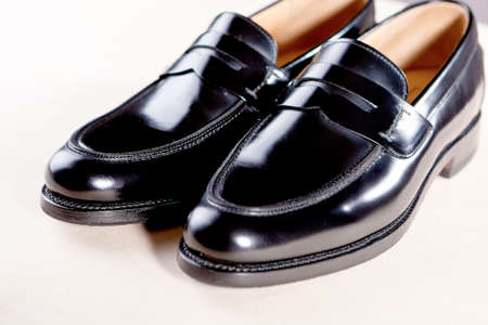 black shoes: Pair of Stylish Expensive Modern Leather Black Penny Loafers Shoes.Closeup Shot. Horizontal  Image Concept