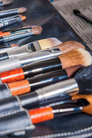 put together: Variety of Professional Makeup Brushes Put Together. Vertical Image Composition Stock Photo
