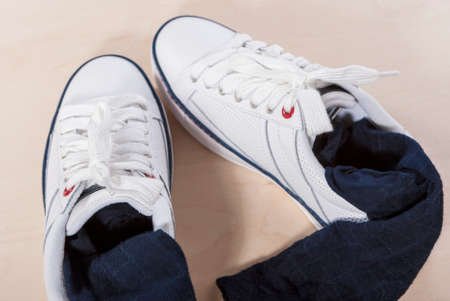 plimsoll: Pair of White Trainers with Socks Inserted Inside. Horizontal Image Stock Photo