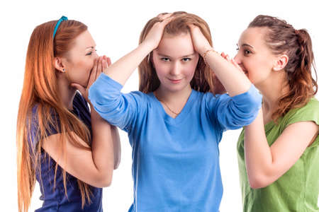 bruit: Girlfriends and Friendship Concept. Three Young caucasian Girlfriends Sharing Their Secrets Whispering to Ears.Isolated Over White Background Stock Photo