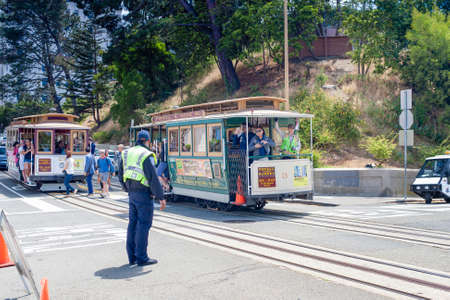 municipal editorial: San-Francisco-United States, July 13, 2014: Authentic San-Francisco Tram Ascending Uphill With People on July 13, 2014 in San-Francisco, California, United States Of America.