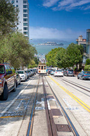 municipal editorial: San-Francisco-United States, July 13, 2014: Authentic San-Francisco Tram Ascending Uphill With People on July 13, 2014 in San-Francisco, California, United States Of America Editorial