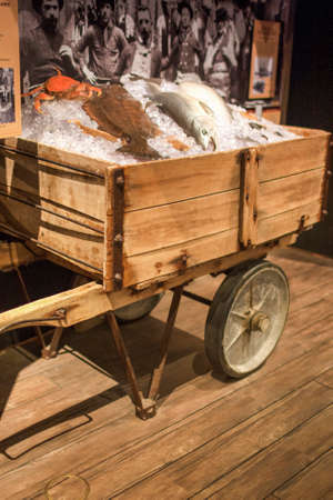 late 50s: San-Francisco-United States, July 13, 2014: Authentic Wharf Ice Cart Used to Move Fish and Ice on Stand in Maritime Museum in San-Francisco on July 13, 2014 in San-Francisco, California, United States Of America.