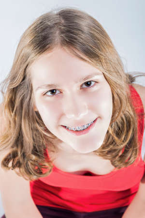 correcting: Oralcare Concepts. Portrait of Smiling Teenager Girl With Oral Teeth Dental Correcting System. Vertical Image Orientation