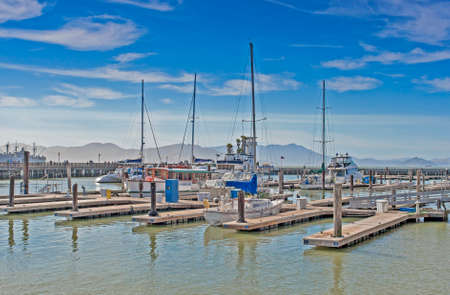 frisco: Colorful Sailing Boats at Fishermans Wharf of San-Francisco Bay in California,United States. Horizontal Image Composition Stock Photo