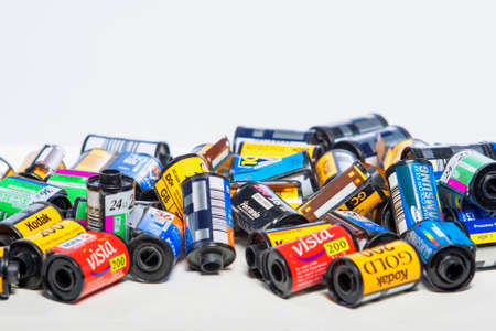 Minsk, Belarus-May 30, 2015: Bulk Variety of Old Photo Films Cassettes of Different World Leading Manufacturers Placed in Heap Together against White Background shot in Studio on May 30, 2015 in Minsk, Republic of Belarus Editorial