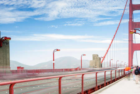 frisco: Blurred Trails of Cars Passing By on The Golden Gate Bridge in San-Francisco in the Afternoon.Horizontal Image Orientation Stock Photo