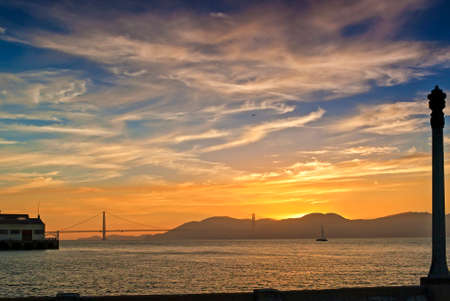 frisco: Golden Hour Sunset in Front of the Golden Gates Bridge in San-Francisco , California. Horizontal Image
